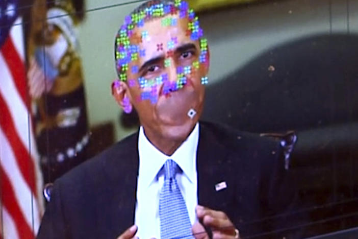 "A fake video featuring former President Obama shows elements of facial mapping used in new ""deepfake"" technology that lets anyone make videos of real people appearing to say things they've never said. (AP Photo)"
