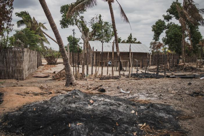 A mound of ashes is seen after an attack in the village of Aldeia da Paz outside Macomia, on Aug. 24, 2019. For the past three years, violence has devastated parts of northern Mozambique, leaving hundreds of thousands displaced.