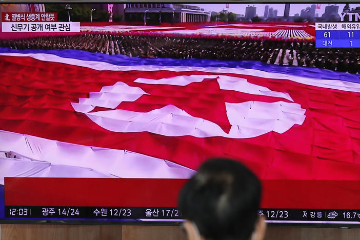 North Korea's flag is seen on a TV screen during a South Korean news program in this file photo from Oct. 10, 2020.