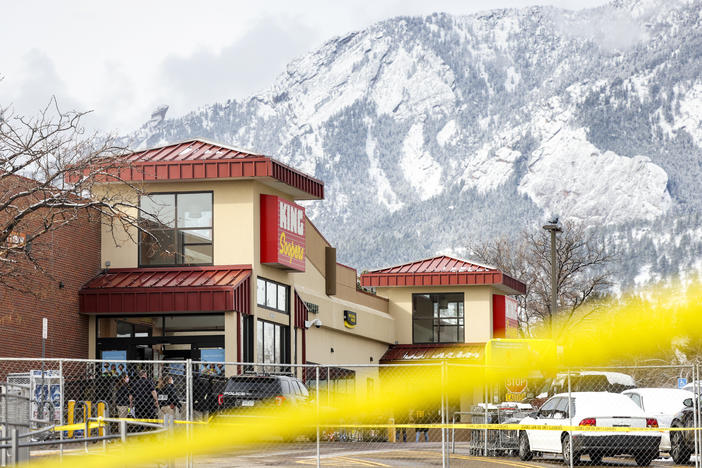 Crime tape surrounds a King Soopers grocery store on March 24 in Boulder, Colo where ten people were killed in a shooting on Monday. State Democrats now say they will consider a statewide assault weapons ban.