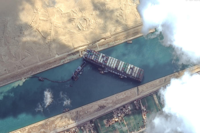 High-resolution satellite imagery shows the Suez Canal and the container ship Ever Given that was finally freed on Monday.