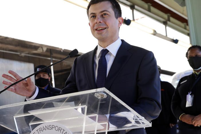 "U.S. Secretary of Transportation Pete Buttigieg speaks to Amtrak employees Feb. 5 during a visit at Union Station in Washington, D.C. In a Thursday interview with NPR's <em>Morning Edition</em>, he said not making infrastructure investment would be a ""threat to American competitiveness."""