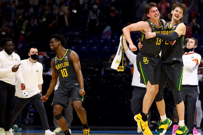 Baylor players (from left) Adam Flagler, Jackson Moffatt and Matthew Mayer celebrate after defeating the Gonzaga Bulldogs in the National Championship game of the 2021 NCAA Men's Basketball Tournament at Lucas Oil Stadium.