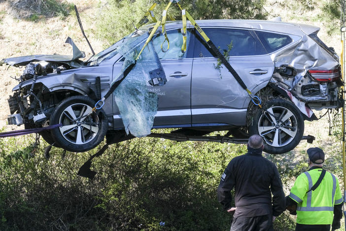 A crane is used to lift a vehicle driven by golfer Tiger Woods following a rollover accident in February in the Rancho Palos Verdes suburb of Los Angeles.