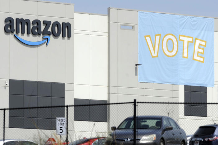 A banner encourages workers to vote in a union election at Amazon's warehouse in Bessemer, Ala.