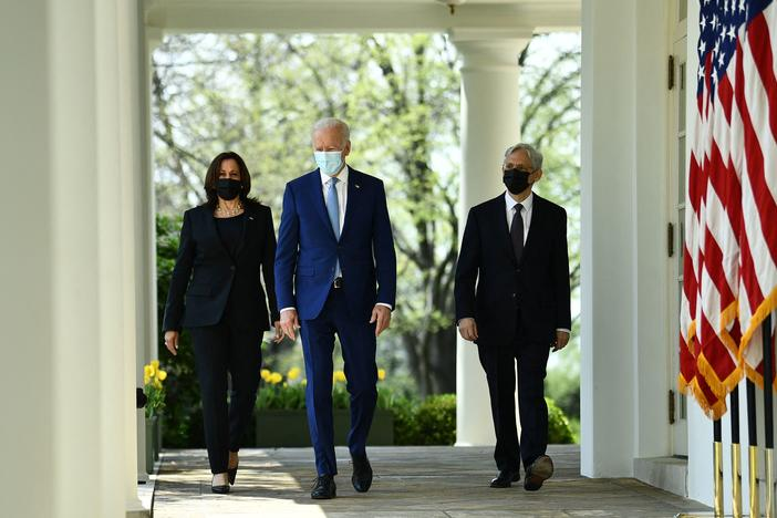 Vice President Harris, President Biden and Attorney General Merrick Garland arrive Thursday at the White House Rose Garden to speak about gun violence prevention.