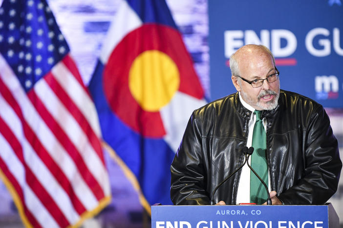Colorado state Rep. Tom Sullivan, pictured here in 2019 introducing former Democratic presidential candidate Michael Bloomberg, says now is not the time to push for a statewide ban on assault-style weapons.
