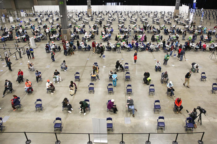 "A mass vaccination site at the Lumen Field Event Center in Seattle had plenty of takers for the COVID-19 vaccine when it opened in mid-March. Though some relatively rare cases of coronavirus infection have been documented despite vaccination, ""I don't see anything that changes our concept of the vaccine and its efficacy,"" says Dr. Anthony Fauci of the National Institutes of Health."