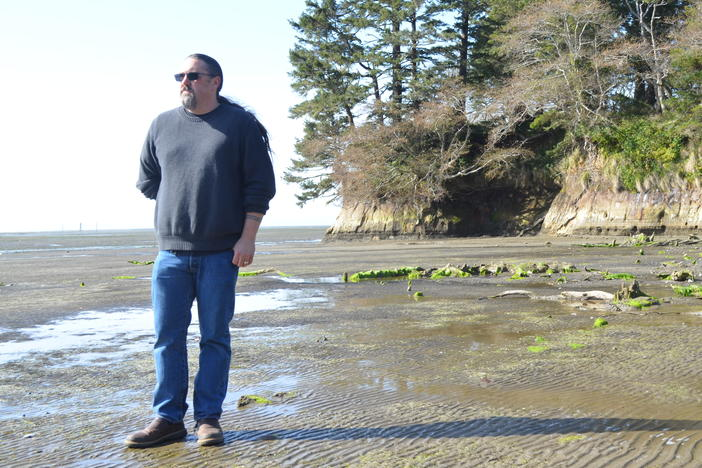 Tony Johnson is chair of the Chinook Indian Nation, a federally unrecognized tribe. He stands on a Willapa Bay, Wash., beach, where he got married and not far from where his ancestors lived.