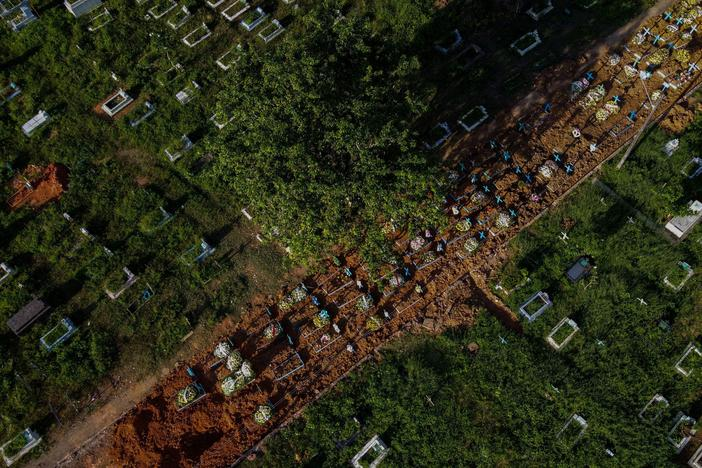 With little space left at Nossa Senhora Aparecida cemetery in Manaus, Brazil, graves of COVID-19 victims line a street, seen in an aerial photo taken on Thursday as the country passed 400,000 virus deaths.