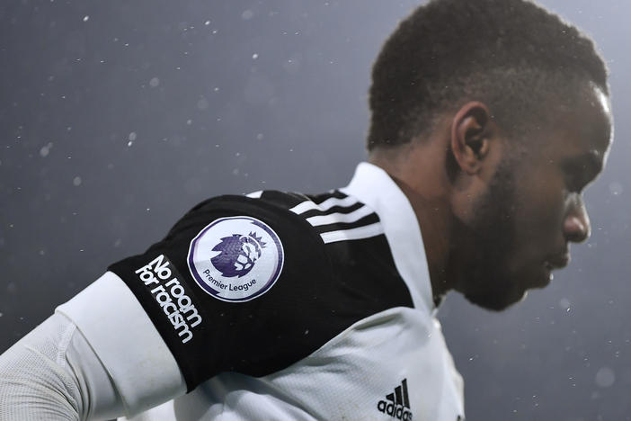 "A ""No room for racism"" logo and Premier League logo is seen on the shirt of Ademola Lookman of Fulham during the Premier League match."