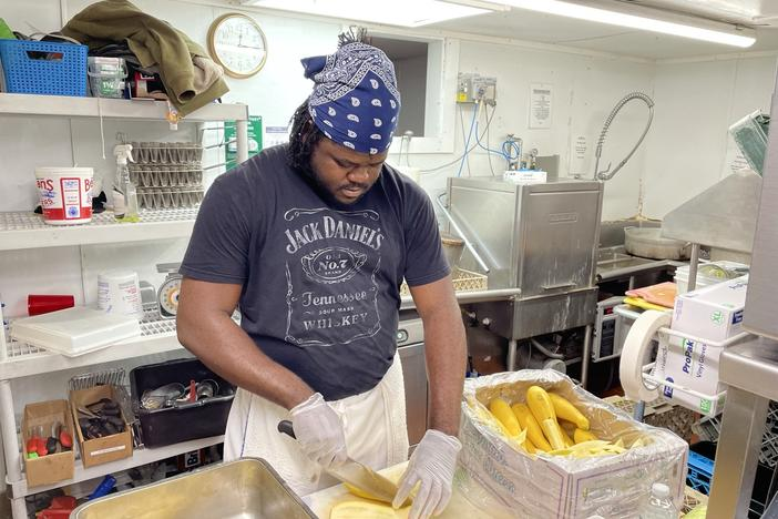 Jason Brissett, a kitchen worker who came to the U.S. last month from Jamaica through an H-2B visa, is bracing for 80-hour workweeks this summer to make up for staffing shortages.