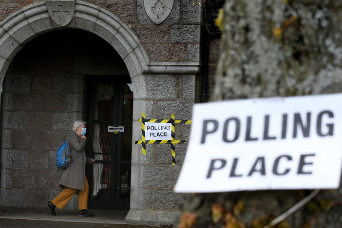 Voters arrive Thursday at the War Memorial building being used as a polling station in Aboyne in Aberdeenshire for Scotland's parliamentary election.
