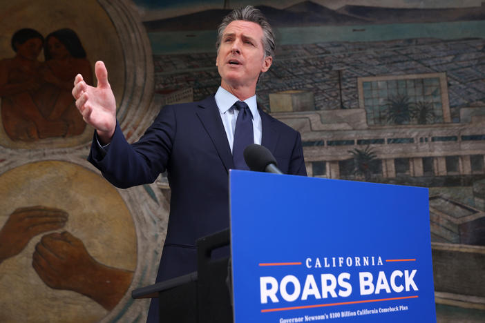 California Gov. Gavin Newsom speaks during a press conference in Oakland, Calif., on Monday where he announced a new round of $600 stimulus checks residents making up to $75,000 a year. Newsom also announced a projected $75.7 billion budget surplus compared to last year's projected $54.3 billion shortfall.