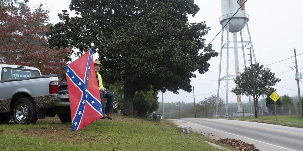 Mark Stephens watches the Trump rally in Manchester, Ga., not far from Joe Biden's speech in Warm Springs, from a hill above the event site. Stephens was asked to leave because of his Confederate battle flag.