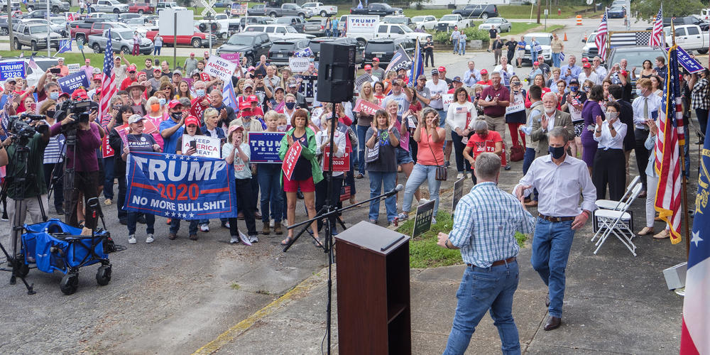Gov. Brian Kemp approaches the podium at a pro-Trump rally in Manchester, Georgia, ahead of Joe Biden's later visit to nearby Warm Springs Oct. 27, 2020.