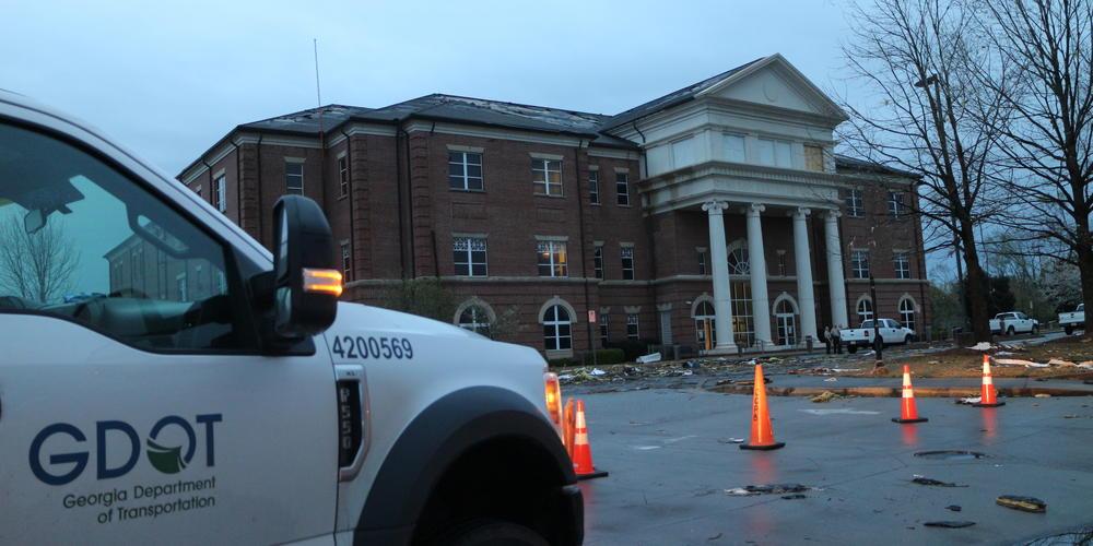 Georgia Dept. of Transportation crews clean up roadways near the Coweta County Court Clerk's Office in Newnan, Ga.