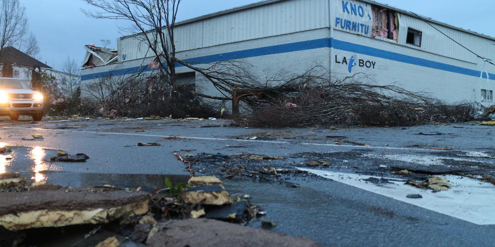 Local store damaged and covered in debris following deadly tornado in Newnan on Friday, March 26, 2021.