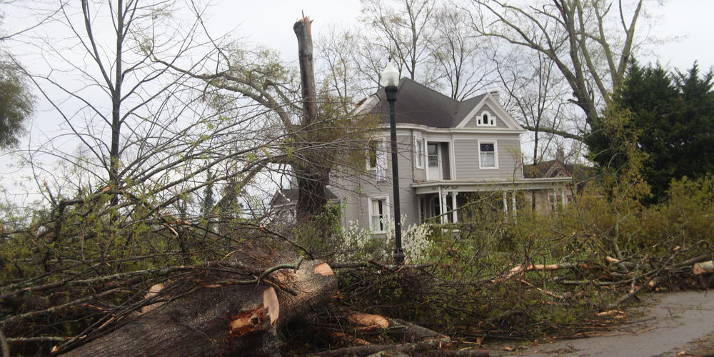 Debris surrounds historic home in Newnan, Ga. on Friday, March 26, 2021.