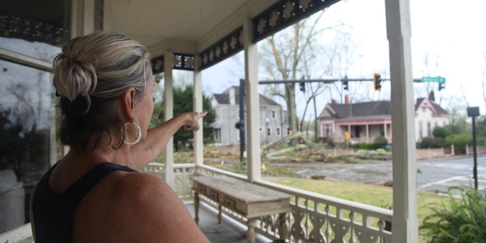 Coweta County resident surveys damage left from overnight storm in Newnan, Ga. on Friday, March 26.