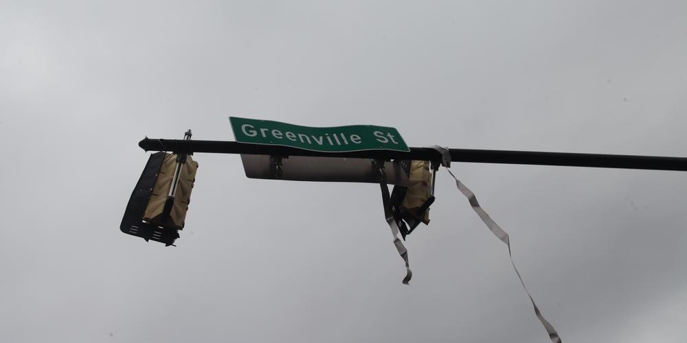 Deadly tornado damages traffic light on Greenville St. in Newnan, Ga. on Friday, March 26, 2021.