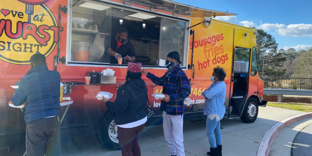 Voters ordering food from food truck at polling place.
