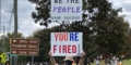 Women holds up you're fired sign