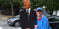 Woman next to cardboard cut out of Biden